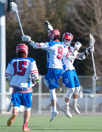 04/20/18 Wesley Bunnell | Staff Berlin boys lax defeated Bristol Eastern 18-3 on Friday afternoon at Sage Park. Kevin Dunn (9) celebrates his goal with teammate Nick Grant (30).