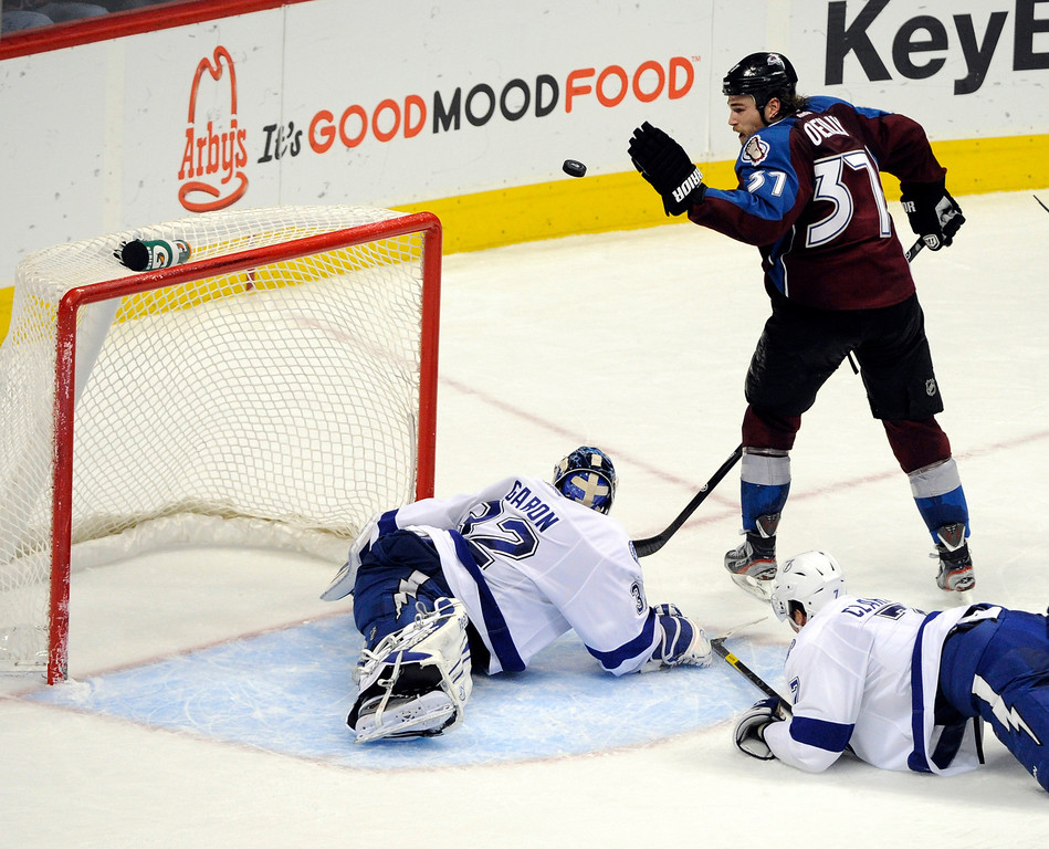 . Ryan O\'Reilly, Colorado Avalanche, slaps the puck into the net against Tampa Bay Lighting goalie Mathieu Garon to no avail in the third period of play at Pepsi Center Friday evening. The goal did not count, but the Avs went on to win 2-1 in overtime.  Andy Cross, The Denver Post