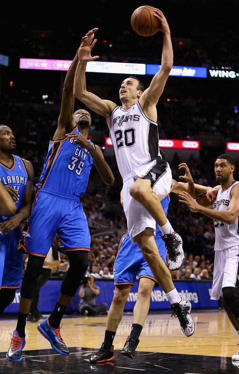 . Manu Ginobili #20 of the San Antonio Spurs drives to the basket against Kevin Durant #35 of the Oklahoma City Thunder in the second quarter during Game Five of the Western Conference Finals of the 2014 NBA Playoffs at AT&T Center on May 29, 2014 in San Antonio, Texas.   (Photo by Ronald Martinez/Getty Images)