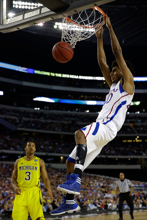 . Kansas \' Kevin Young (40) dunks the ball against Michigan during the first half of a regional semifinal game in the NCAA college basketball tournament, Friday, March 29, 2013, in Arlington, Texas. (AP Photo/David J. Phillip)