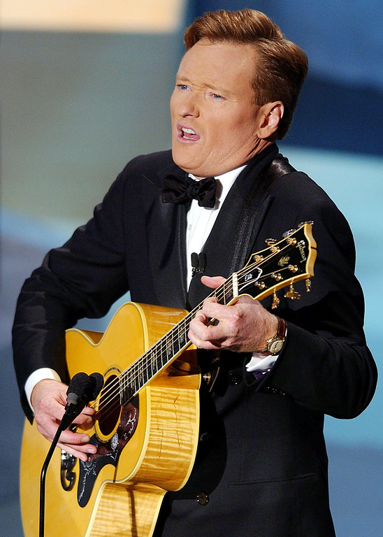 . Host Conan O\'Brien jokes by playing a Jethro Tull song at the 54th Annual Primetime Emmy Awards in the Shrine Auditorium in Los Angeles, CA, 22 September 2002.  LUCY NICHOLSON/AFP/Getty Images