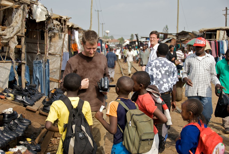 Andy Brown talking to children in Kibera  OFM team