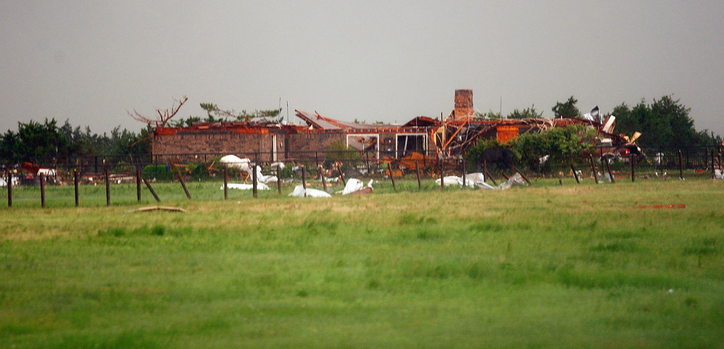 . A home, damaged by a tornado, is seen south along Interstate-40 eastbound just east of El Reno, Oklahoma May 31, 2013. Violent thunderstorms spawned tornadoes that menaced Oklahoma City and its already hard-hit suburb of Moore on Friday, killing a mother and her baby, and officials worried that drivers stuck on freeways could be trapped in the path of dangerous twisters. One twister touched down on Interstate 40 and was headed toward Oklahoma City.  REUTERS/Bill Waugh