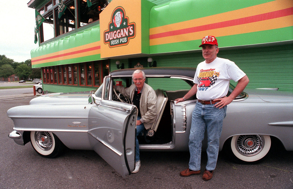 ". Stan Spindler (left) and Don Schieltz both of Rochester Hills have produced a CD with original Woodward Dream Cruise music entitled ""Stan Spindler and the Dualtones.\"" They are seen here with 56\' Eldorado Seville outside Duggan\'s Pub in Royal Oak."