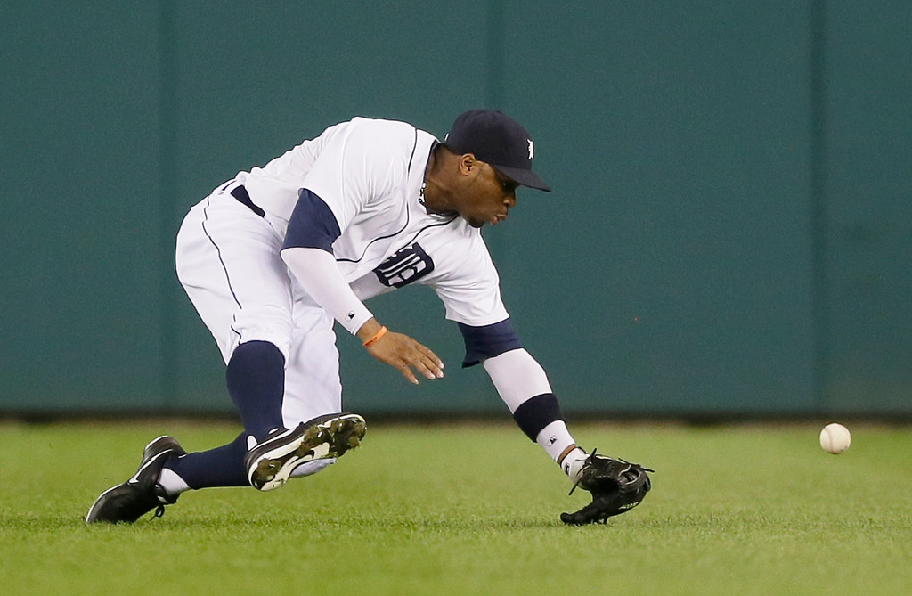 . Detroit Tigers center fielder Rajai Davis misplays a single by Kansas City Royals\' Omar Infante during the fifth inning of a baseball game in Detroit, Tuesday, Sept. 9, 2014. (AP Photo/Carlos Osorio)