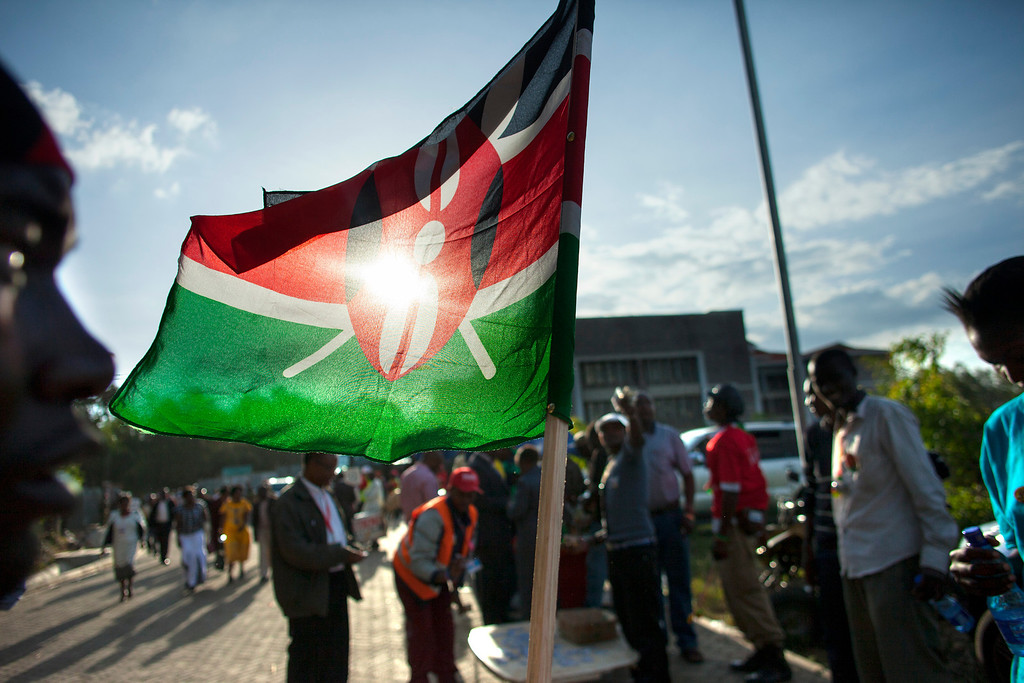 . A supporter of Kenyan presidential candidate Uhuru Kenyatta sells Kenyan flags at the Catholic University where Uhuru Kenyatta gave the acceptance speech of his victory in Kenya\'s national elections on March 9, 2013 in Nairobi.   AFP PHOTO / GEORGINA Goodwin/AFP/Getty Images