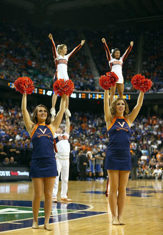 . The Virginia Cavaliers cheerleaders cheer on her team during their game against the Duke Blue Devils in the finals of the 2014 Men\'s ACC Basketball Tournament at Greensboro Coliseum on March 16, 2014 in Greensboro, North Carolina.  (Photo by Streeter Lecka/Getty Images)