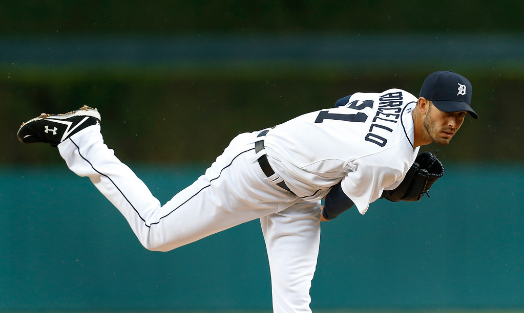 . Detroit Tigers pitcher Rick Porcello throws a warmup pitch against the Houston Astros in the first inning of a baseball game in Detroit Wednesday, May 7, 2014. (AP Photo/Paul Sancya)
