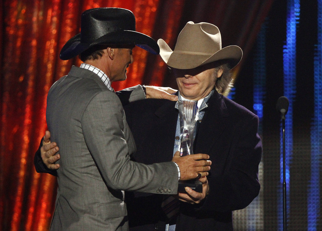 ". Tim McGraw, left, accepts his award from Dwight Yokam at CMT ""Artists of the Year\"" show held at the Music City Center on Tuesday, Dec. 3, 2013, in Nashville, Tenn. (Photo by Wade Payne/Invision/AP)"