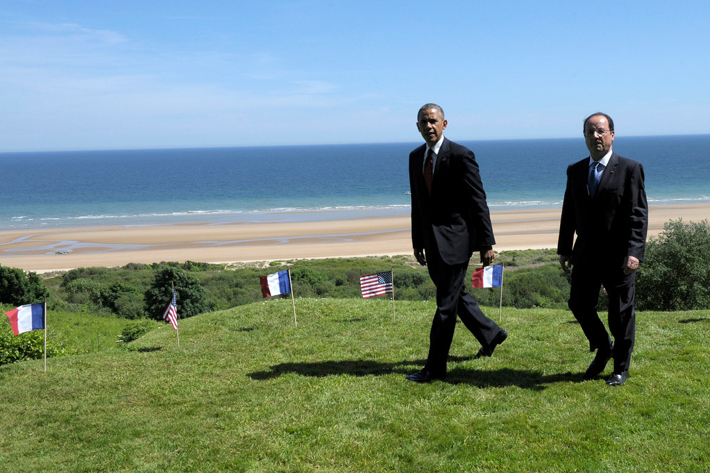. US President Barack Obama, left, and  French President Francois Hollande look out over Omaha beach during a joint French-US D-Day commemoration ceremony at the Normandy American Cemetery and Memorial in Colleville-sur-mer, Normandy, France, Friday June 6, 2014, marking the 70th anniversary of the World War II Allied landings in Normandy. (AP Photo/Alain Jocard, pool)
