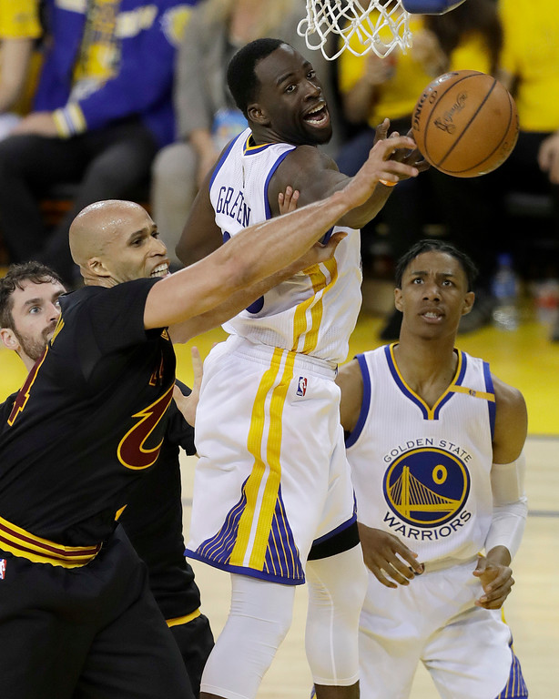 . Golden State Warriors forward Draymond Green, top, reaches for the ball in front of guard Patrick McCaw (0) and Cleveland Cavaliers forward Richard Jefferson during the second half of Game 2 of basketball\'s NBA Finals in Oakland, Calif., Sunday, June 4, 2017. (AP Photo/Marcio Jose Sanchez)