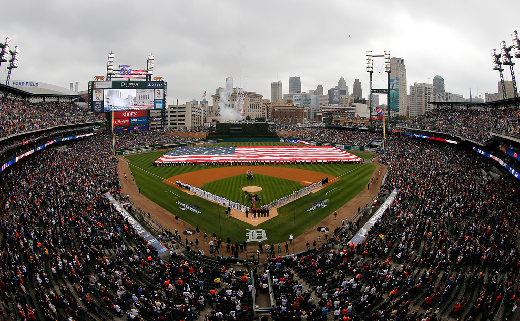 . American flag is displayed on the field during the national anthem before Game 3 of the American League baseball championship series between the Boston Red Sox and the Detroit Tigers Tuesday, Oct. 15, 2013, in Detroit. (AP Photo/Tim Donnelly)
