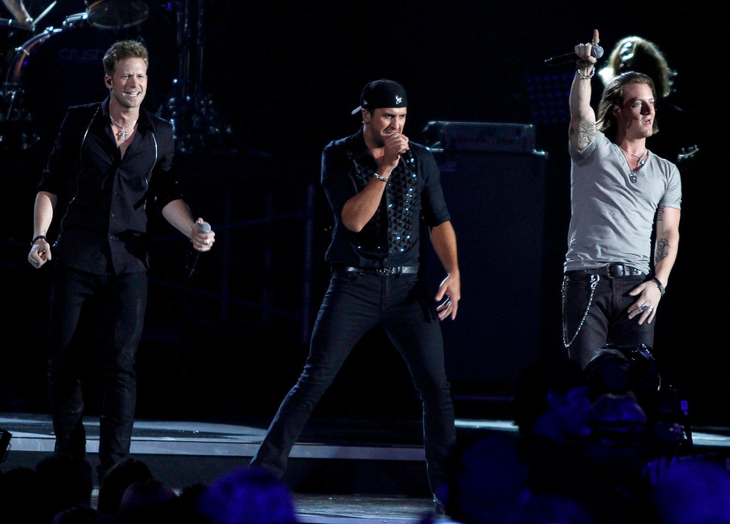 . Florida Georgia Line, Tyler Hubbard, left, and Brian Kelley, right,  perform with Luke Bryan, during the opening of the 47th annual CMA Awards at Bridgestone Arena on Wednesday, Nov. 6, 2013, in Nashville, Tenn. (Photo by Wade Payne/Invision/AP)