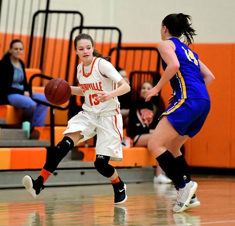 1/15/2019 Mike Orazzi | Staff Terryville High School's Alivia Cote (13) and Housatonic Regional's Ella Segalla (14) at Terryville High School Tuesday night.