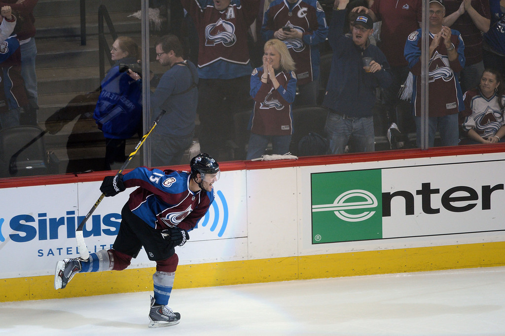 . DENVER, CO - APRIL 26: P.A. Parenteau (15) of the Colorado Avalanche celebrates his game-tying 3-3 goal against the Minnesota Wild during the third period. The Colorado Avalanche hosted the Minnesota Wild during game five of the first round of the NHL Stanley Cup Playoffs at the Pepsi Center on Saturday, April 26, 2014. (Photo by Karl Gehring/The Denver Post)