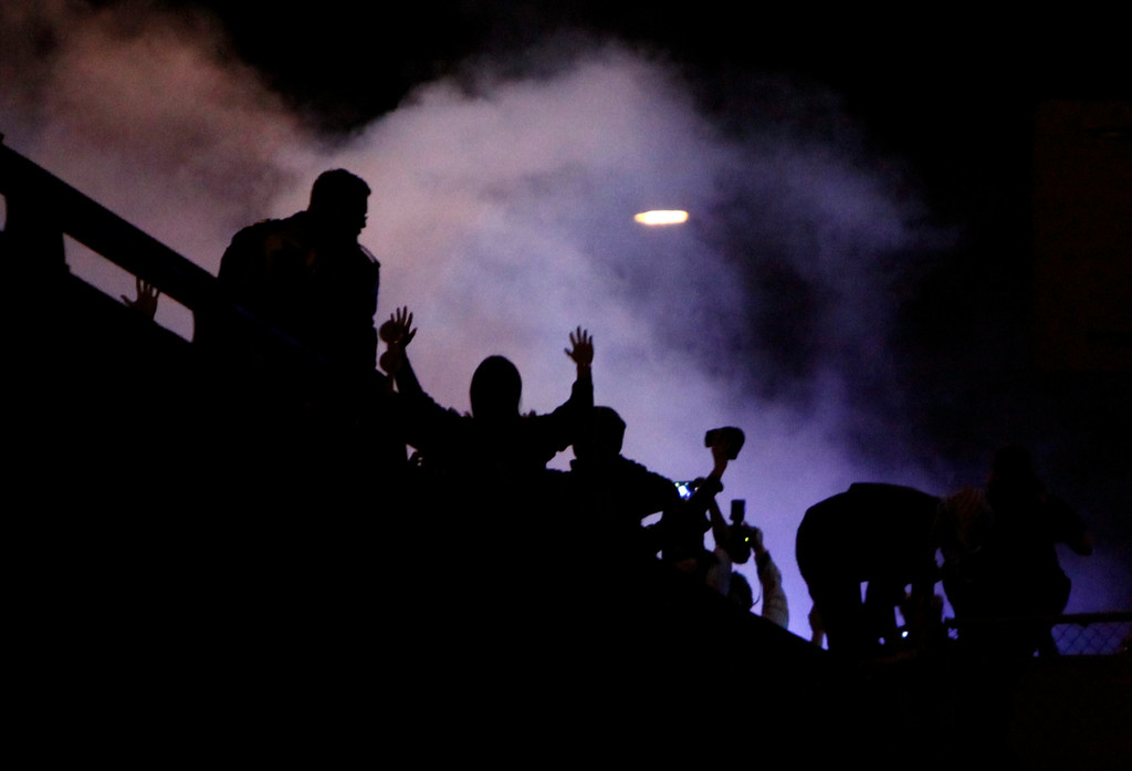 . Police deploy smoke attempting to push back protesters on Highway 24 in Oakland, Calif., Sunday evening, Dec. 7, 2014, during a second consecutive night of local unrest over the killings of two unarmed black men by police in Ferguson, Mo., and New York. (Karl Mondon/Bay Area News Group)