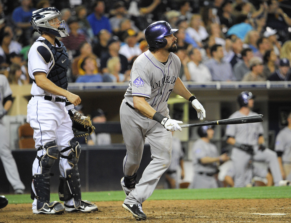 . Todd Helton #17 of the Colorado Rockies and Nick Hundley #4 of the San Diego Padres watch the flight of Helton\'s solo home run during the ninth inning of a baseball game at Petco Park on September 6, 2013 in San Diego, California.  (Photo by Denis Poroy/Getty Images)