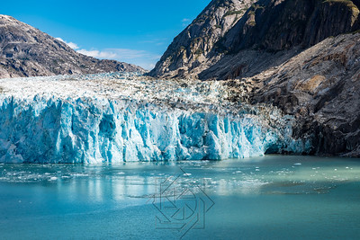 Wide angle view of glacier face with blue ice
