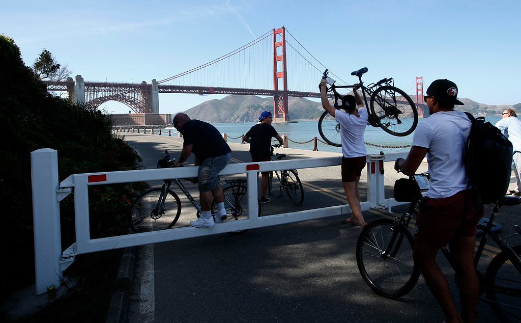 . Cyclists ignore a road closure sign at Fort Point in San Francisco, Calif., on Tuesday, Oct. 1, 2013, and visited the Civil War site despite its closure, a result of the partial federal government shutdown. (Karl Mondon/Bay Area News Group)