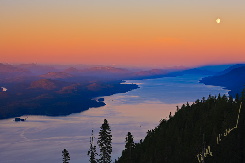 Aerial view over Johnstone Strait and Robson Bight, looking southeast after a beautiful soft sunset on a full moon twilight, Vancouver Island, British Columbia, Canada.