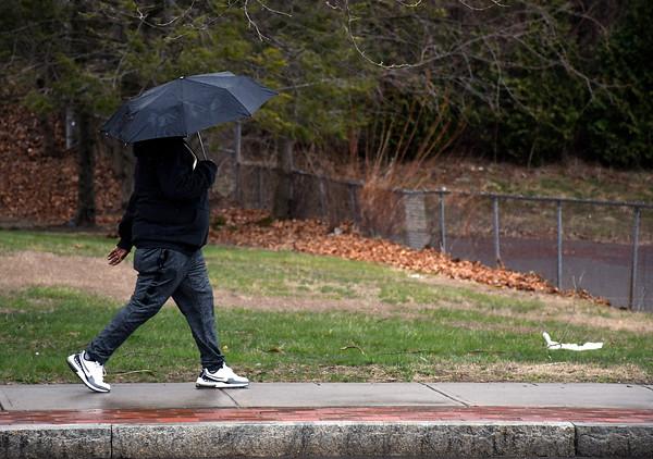 4/19/2018 Mike Orazzi | Staff A woman walks along North Main Street on a rainy Thursday in Bristol.