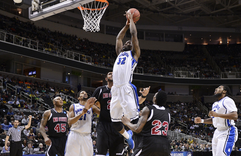 . Cory Remekun #32 of the Saint Louis Billikens dunks a rebound against the New Mexico State Aggies in the first half during the second round of the 2013 NCAA Men\'s Basketball Tournament at HP Pavilion on March 21, 2013 in San Jose, California.  (Photo by Thearon W. Henderson/Getty Images)