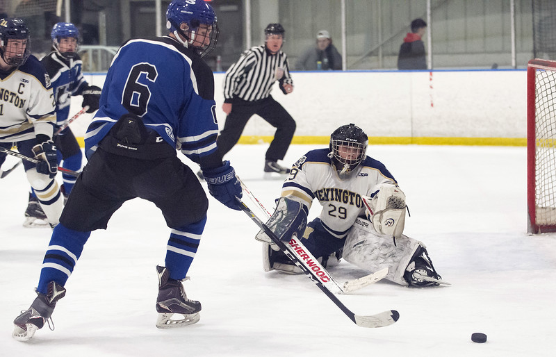 02/26/20   Wesley Bunnell | Staff  Newington Co-op hockey vs Hall-Southington on Wednesday night at Newington Arena. Newington's goalkeeper Andrew Fogarty (29) and Hall-Southington's Sean Roach (6).