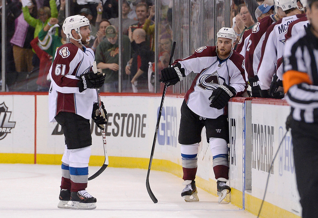 . Colorado Avalanche defenseman Andre Benoit (61) and Colorado Avalanche center Ryan O\'Reilly (90) look dejected after losing to the Minnesota Wild 2-1 April 24, 2014 in Game 4 of the Stanley Cup Playoffs at Xcel Energy Center. (Photo by John Leyba/The Denver Post)