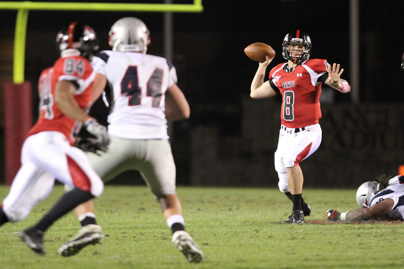 Lucas Beatty (8) looks for Demarcus White (84) as he prepares to throw the ball