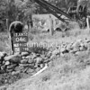 NJ910904K, Man marking Ordnance Survey minor control revision point with an arrow in 1950s