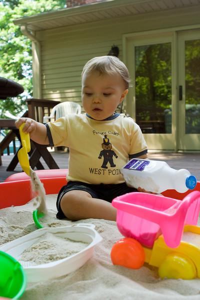 K.C. enjoys playing in his sandbox.