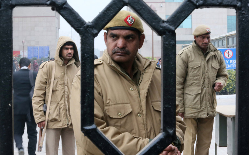 . Indian policemen stand guard at the District Court complex where a new fast-track court was inaugurated Wednesday to deal specifically with crimes against women, in New Delhi, India, Thursday, Jan. 3, 2013. Indian police were preparing Thursday to file rape and murder charges against a group of men accused of sexually assaulting a 23-year-old university student for hours on a moving bus in New Delhi. The Dec. 16 attack on the woman, who later died of her injuries, has caused outrage across India, sparking protests and demands for tough new rape laws, better police protection for women and a sustained campaign to change society\'s views about women. (AP Photo/ Manish Swarup)
