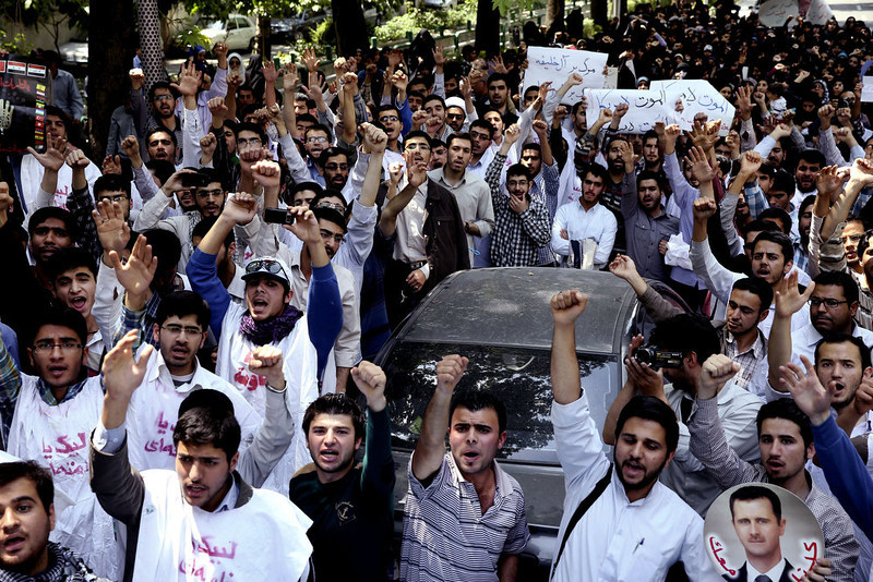 . Iranian and Syrian students chant slogans during an anti-Israel demonstration in front of the UN office in Tehran, Iran, Monday, May 6, 2013. Iran condemns Israeli air strikes on Syria and urged countries in the region to stand against the attack. (AP Photo/Ebrahim Noroozi)
