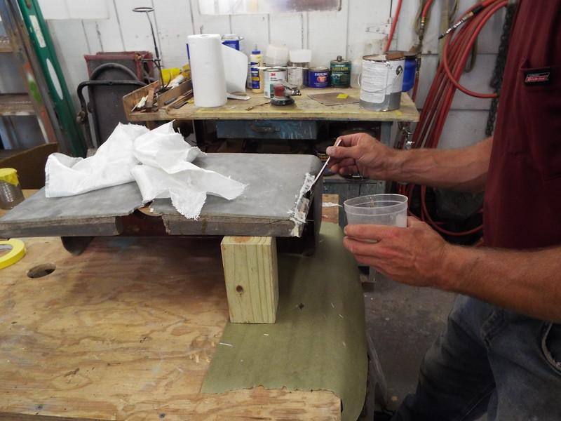 Glassing the corner back together.