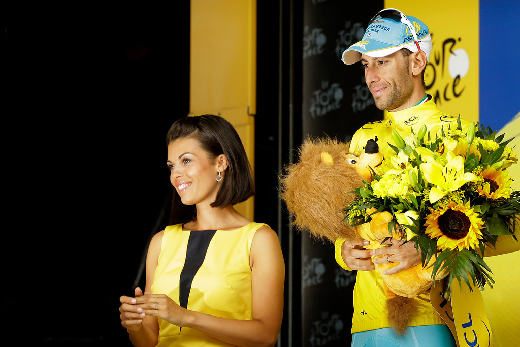 . Italy\'s Vincenzo Nibali, wearing the overall leader\'s yellow jersey, celebrates on the podium of the fifteenth stage of the Tour de France cycling race over 222 kilometers (137.9 miles) with start in Tallard and finish in Nimes, France, Sunday, July 20, 2014. (AP Photo/Laurent Cipriani)