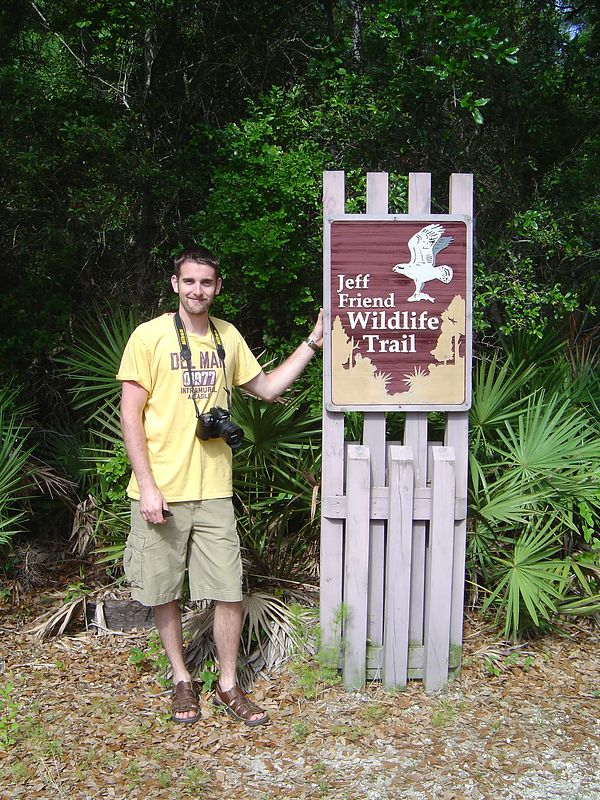 Miles holding up the sign at the wildlife refuge.