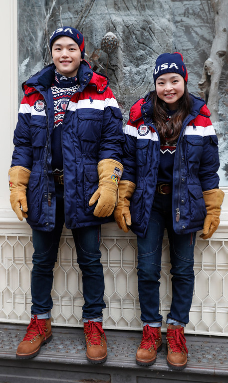 . Ice dancing pair Alex and Maia Shibutani, a brother and sister team, pose for photographs wearing Team USA Opening Ceremony uniforms designed by David Lauren for Polo Ralph Lauren for the upcoming Winter Olympics in South Korea, Monday, Jan. 22, 2018, outside the brand\'s Prince Street store in New York. The parkas have a battery-operated, built-in heating element that can be adjusted using a cell phone. (AP Photo/Kathy Willens)