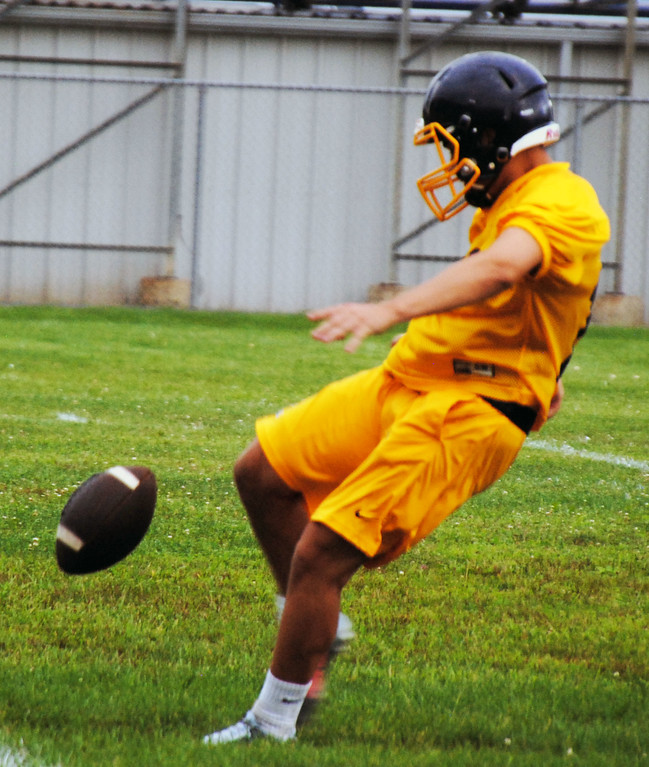 . Jon Behm - The Morning Journal<br> Scenes from Olmsted Falls\' first day of football practice on July 30.