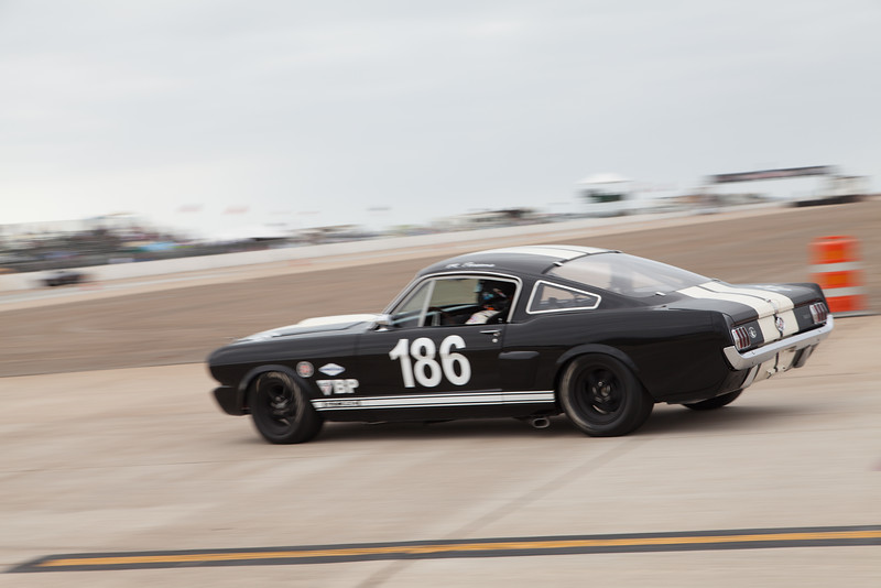 Michael Parson races towards turn 11 in his 1966 Shelby Mustang GT 350. © 2014 Victor Varela