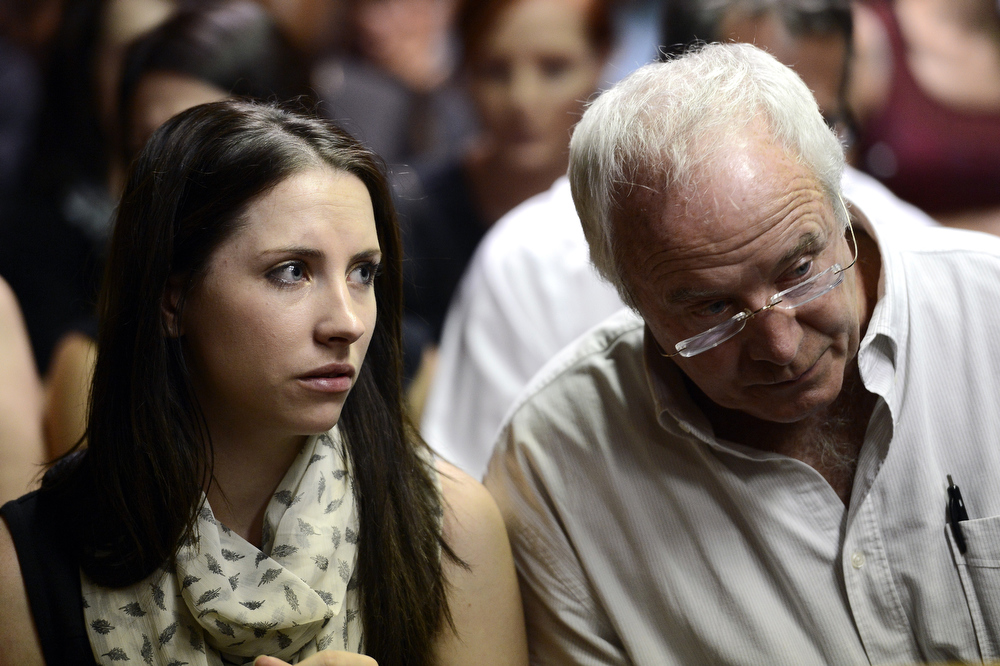 . The father of South African Olympic sprinter Oscar Pistorius, Henke (R), and the sister of the athlete, Aimee(L) sit on February 19, 2013 after his bail hearing was adjourned at the Magistrate Court in Pretoria to allow the prosecution time to study affidavits submitted by the defense. Pistorius is battling to secure bail as he appeared on charges of murdering his model girlfriend Reeva Steenkamp on February 14, Valentine\'s Day. South African prosecutors argued that Pistorius was guilty of premeditated murder in Steenkamp\'s death, a charge which could carry a life sentence.  STEPHANE DE SAKUTIN/AFP/Getty Images