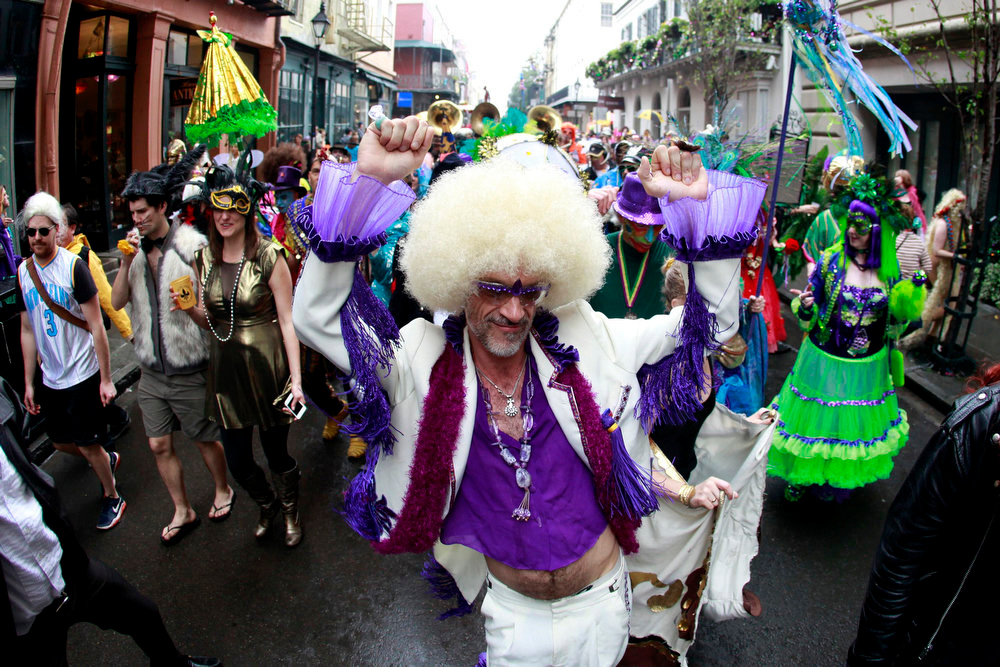 . Revelers parade through the French Quarter on Mardi Gras Day in New Orleans, Louisiana February 12, 2013. REUTERS/Sean Gardner