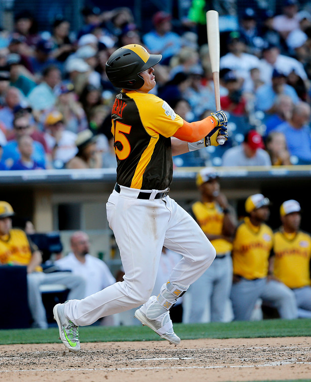 . U.S. Team\'s Ryon Healy, of the Oakland Athletics, hits against the World Team during the seventh inning of the All-Star Futures baseball game, Sunday, July 10, 2016, in San Diego. (AP Photo/Lenny Ignelzi)