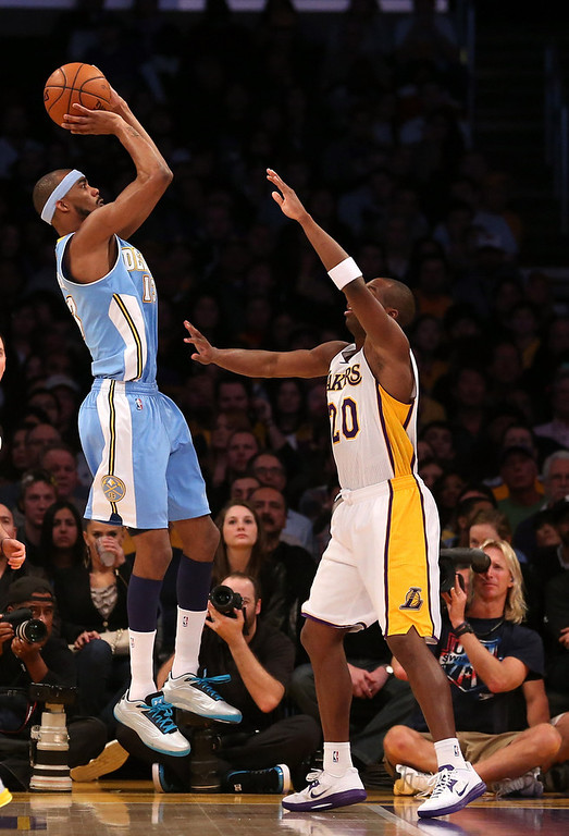 . Corey Brewer #13 of the Denver Nuggets shoots over Jodie Meeks #20 of the Los Angeles Lakers at Staples Center on January 6, 2013 in Los Angeles, California.   (Photo by Stephen Dunn/Getty Images)