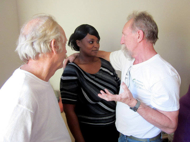 Charlie Thell, Alethia Starling and Tim DuBois after the Nov. 16, 2012, dedication of Alethia's home. Thell and DuBois drove from Minnesota four times to help Alethia work on the home.