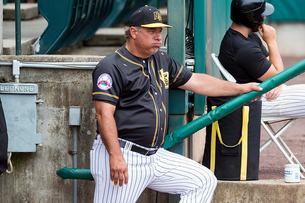 07/18/19 Wesley Bunnell | Staff The New Britain Bees vs the Southern Maryland Blue Crabs in a noon start double header on Thursday July 18, 2019. Manager Mauro Gozzo spits sunflower seeds as he stands on the dugout steps.