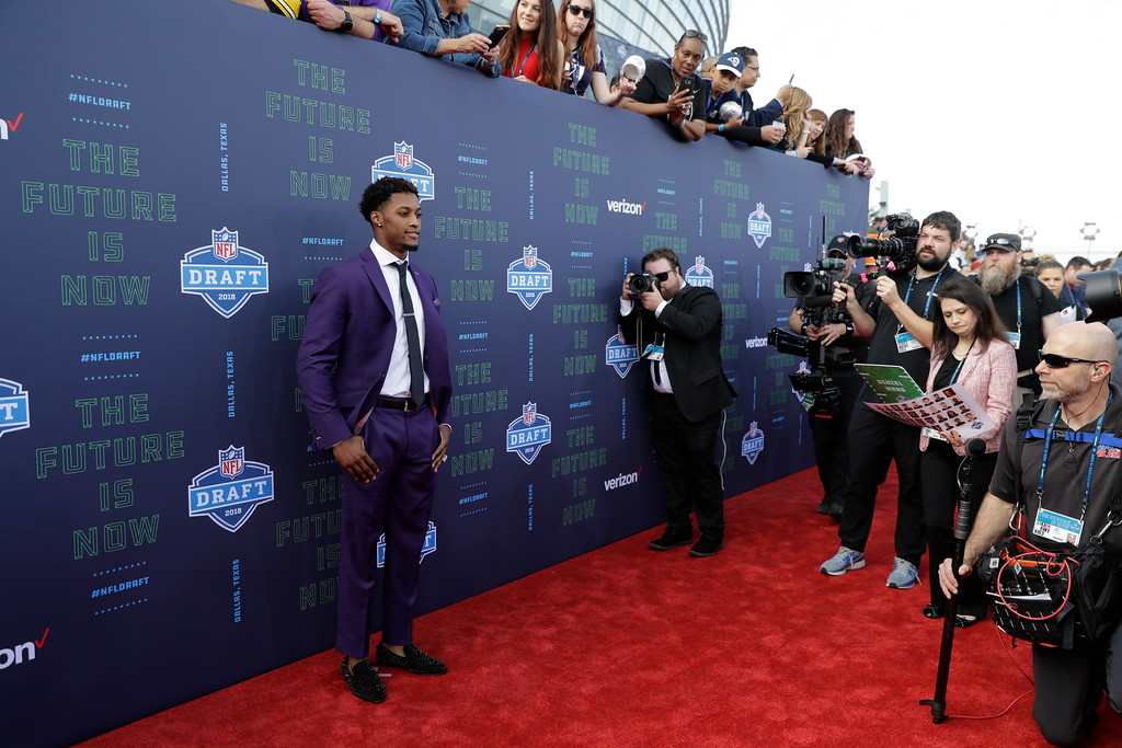 . Ohio State\'s Denzel Ward poses for photos on the red carpet before the first round of the NFL football draft, Thursday, April 26, 2018, in Arlington, Texas. (AP Photo/Eric Gay)