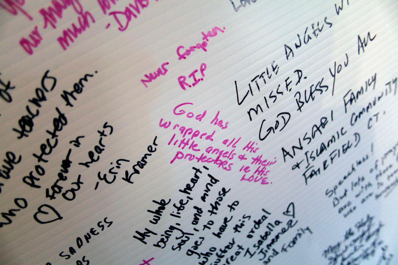 Description of . Messages are written on a board dedicated to the victims killed at Sandy Hook Elementary School displayed at Saint Rose of Lima Roman Catholic Church in Newtown, Connecticut December 15, 2012. People in the small Connecticut community of Newtown grieved on Saturday over one of the worst mass shootings in U.S. history and police sought answers about what drove a 20-year-old gunman to slaughter 20 children at Sandy Hook Elementary School.  REUTERS/Joshua Lott