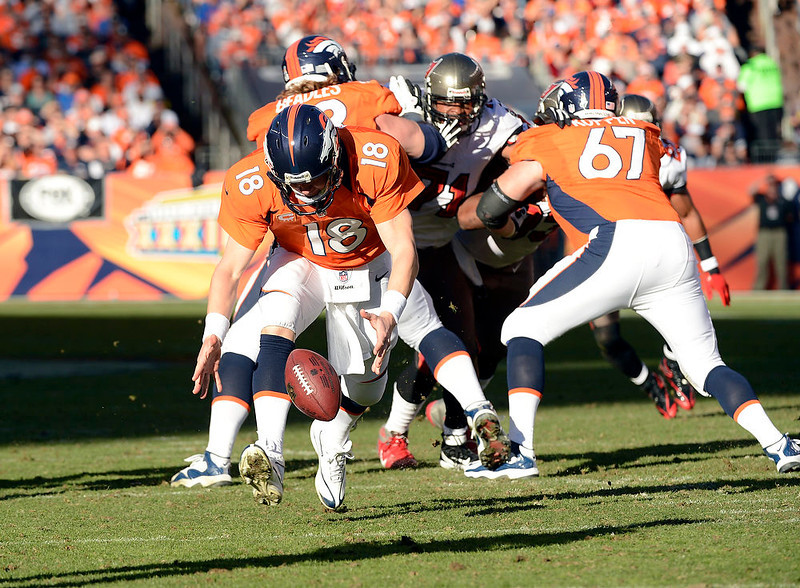 . Quarterback Peyton Manning #18 tries to pick up the ball after it was centered past him making it 4th and 6 during the first half.  The Denver Broncos vs The Tampa Bay Buccaneers at Sports Authority Field Sunday December 2, 2012. Joe Amon, The Denver Post
