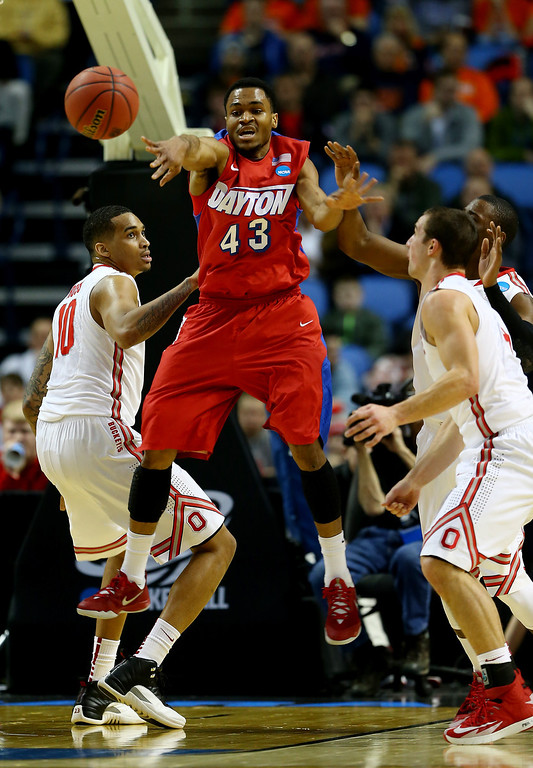 . Vee Sanford #43 of the Dayton Flyers passes the ball as LaQuinton Ross #10 of the Ohio State Buckeyes defends during the second round of the 2014 NCAA Men\'s Basketball Tournament at the First Niagara Center on March 20, 2014 in Buffalo, New York.  (Photo by Elsa/Getty Images)