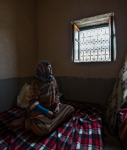 A berber woman from the high Atlas inside her house.  Tamtetoucht, Morocco, 2018.